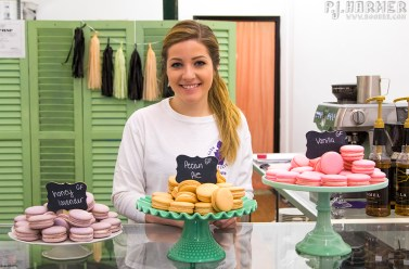 Kallista -- the owner of Lola Dessert Shoppe -- showing off some of her macarons.