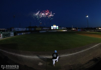 One of Southern Maryland's coaches watches fireworks following the game.