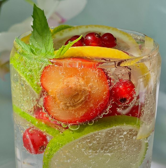 Glass of carbonated hop water with fruit added