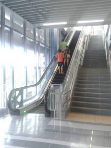 Going up the steep escalators at the MRT station