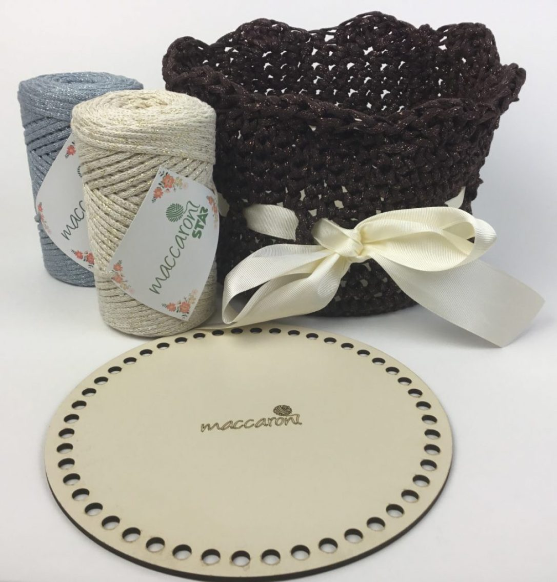 Crochet Basket Kit available in three colors with round wooden base, cotton yarn with lurex sparkle, and pattern.