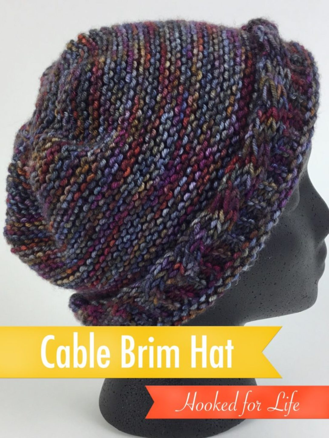 Free Knit Hat pattern with reversible cabled brim. Can be work slouchy or close, knit on straight or circular needles. Worsted weight yarn. #freeknitpattern #cableknitting #hat