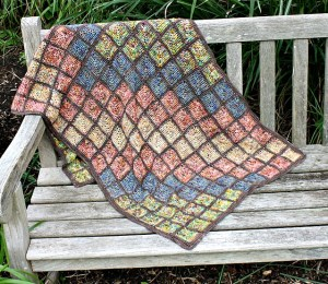 Mosaic Tile Wrap crochet pattern in crocheted mitered squares from Hooked for Life. $5 on Ravelry