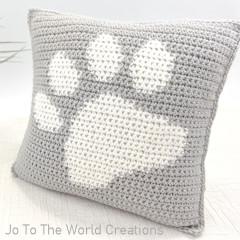 A thumbnail photo of the Paw Print Pillow free crochet pattern