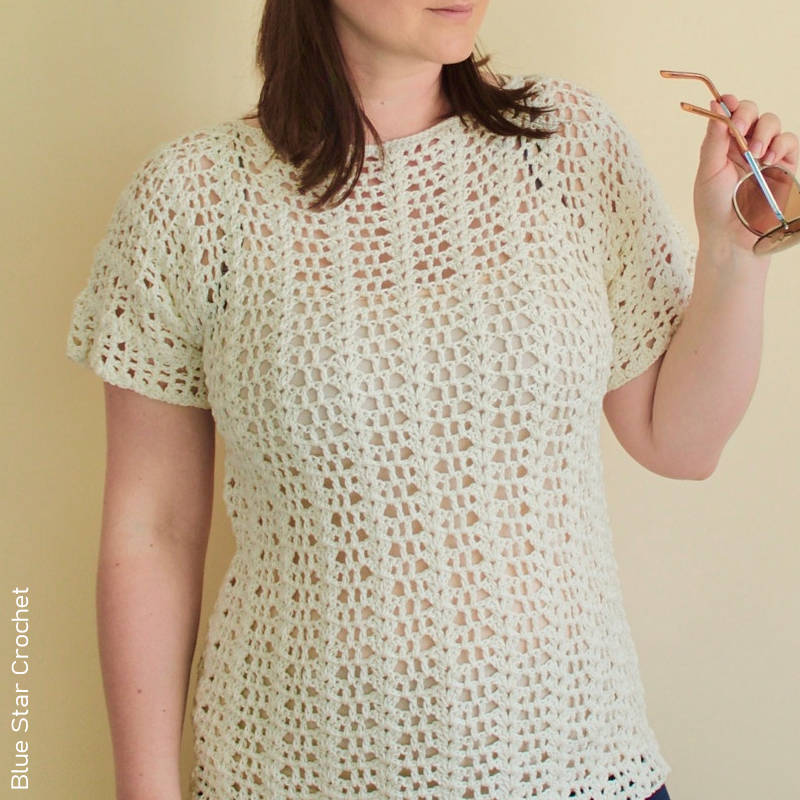 A beautiful, cream coloured, lacey crocheted t-shirt