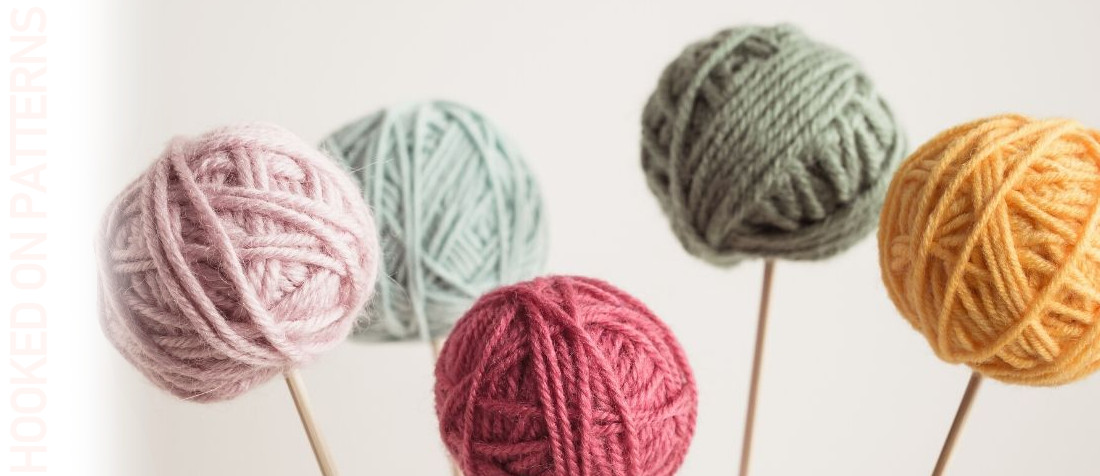 A photo of small balls of different coloured yarn representing the blog post for free scrap yarn projects