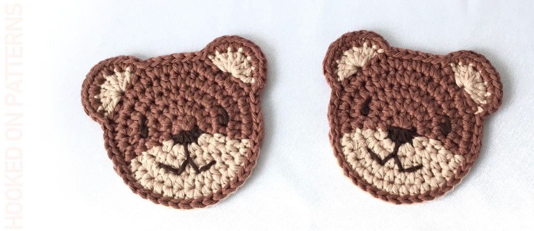 A close up photo of 2 crocheted teddy bear coasters
