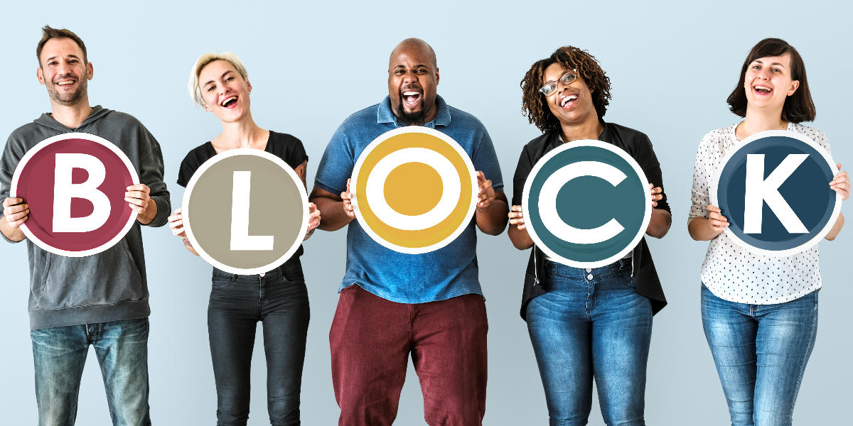 5 people holding letter plaques spelling out BLOCK. Featured image for blocking print friendly websites.