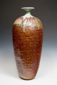 hand built coiled vessel 3 feet tall (one meter)– wood fired. The very top is the only thing glazed prior to firing. The bottom part is ash deposit from the firing. SOLD