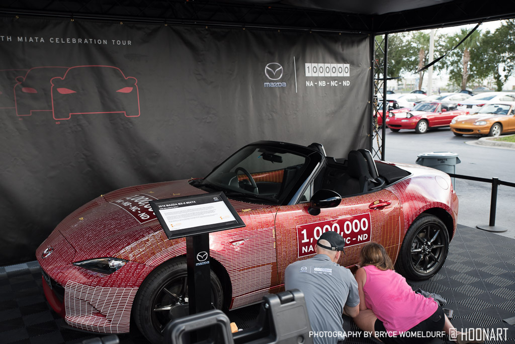 Person signing the millionth Miata