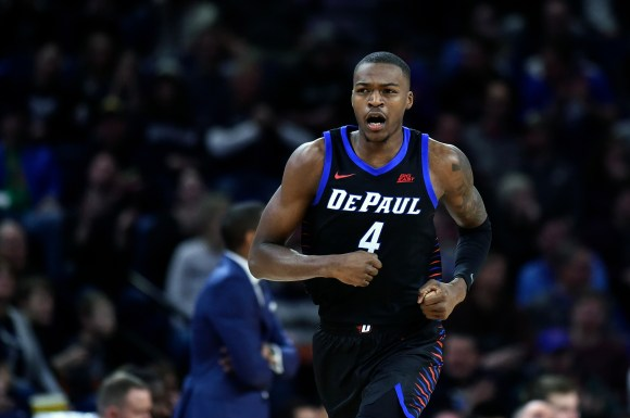 Jan 18, 2020; Chicago, Illinois, USA; DePaul Blue Demons forward Paul Reed (4) reacts after scoring in the first half against the Butler Bulldogs at Wintrust Arena.