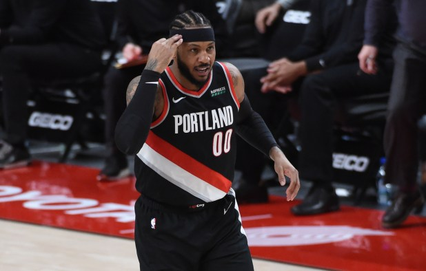 February 12, 2021;  Portland, Oregon, United States;  Portland Trail Blazers forward Carmelo Anthony (00) reacts after scoring a three-point shot during the second half of the game against the Cleveland Cavaliers at the Moda Center.