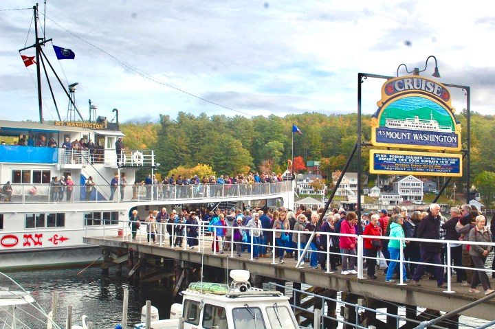 crowds of people boarding and disembarking the Mount Washington cruise ship