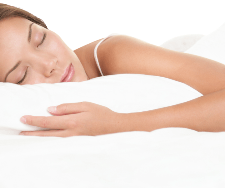 Women sleeping soundly on fluffy white bedding