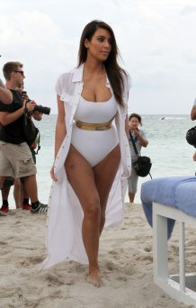 KIM KARDASHIAN in White Swimsuit on the Beach in Miami