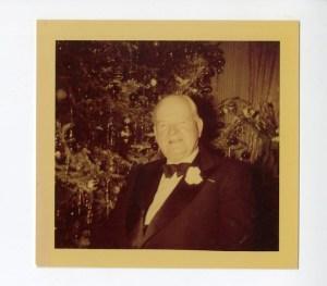 ca. Dec. 1952, Herbert Hoover in front of Christmas tree.