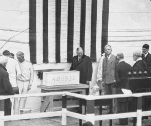 Presdient Hoover applies mortar to the cornerstone of the new Supreme Court building. 10/13/1932