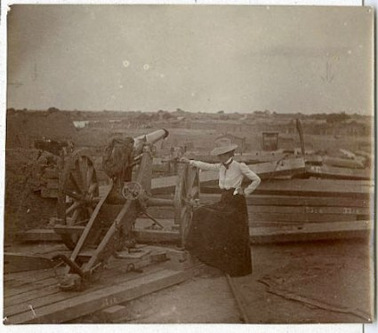 Lou Hoover standing by a cannon, The Boxer Rebellion, ca. 1900.