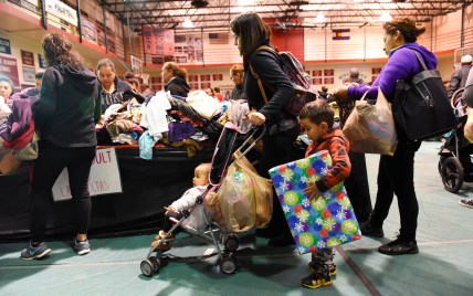 DENVER, CO- DECEMBER 9, 2017: Colorado Academy high school students held their 24th annual Students H.O.P.E. event at the school on Saturday, December 9, 2107. The entirely student run event gives gently used clothing, baby care items, new holiday toys to Denver families. 2,000 people attended and also could visit with Santa, receive flu shots, eye screenings and a lunch meal. (Photo by Cyrus McCrimmon for Colorado Academy)