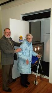 Project manager and trustee, Duane Stinchfield helps Sonya Hawkins onto the new lift.
