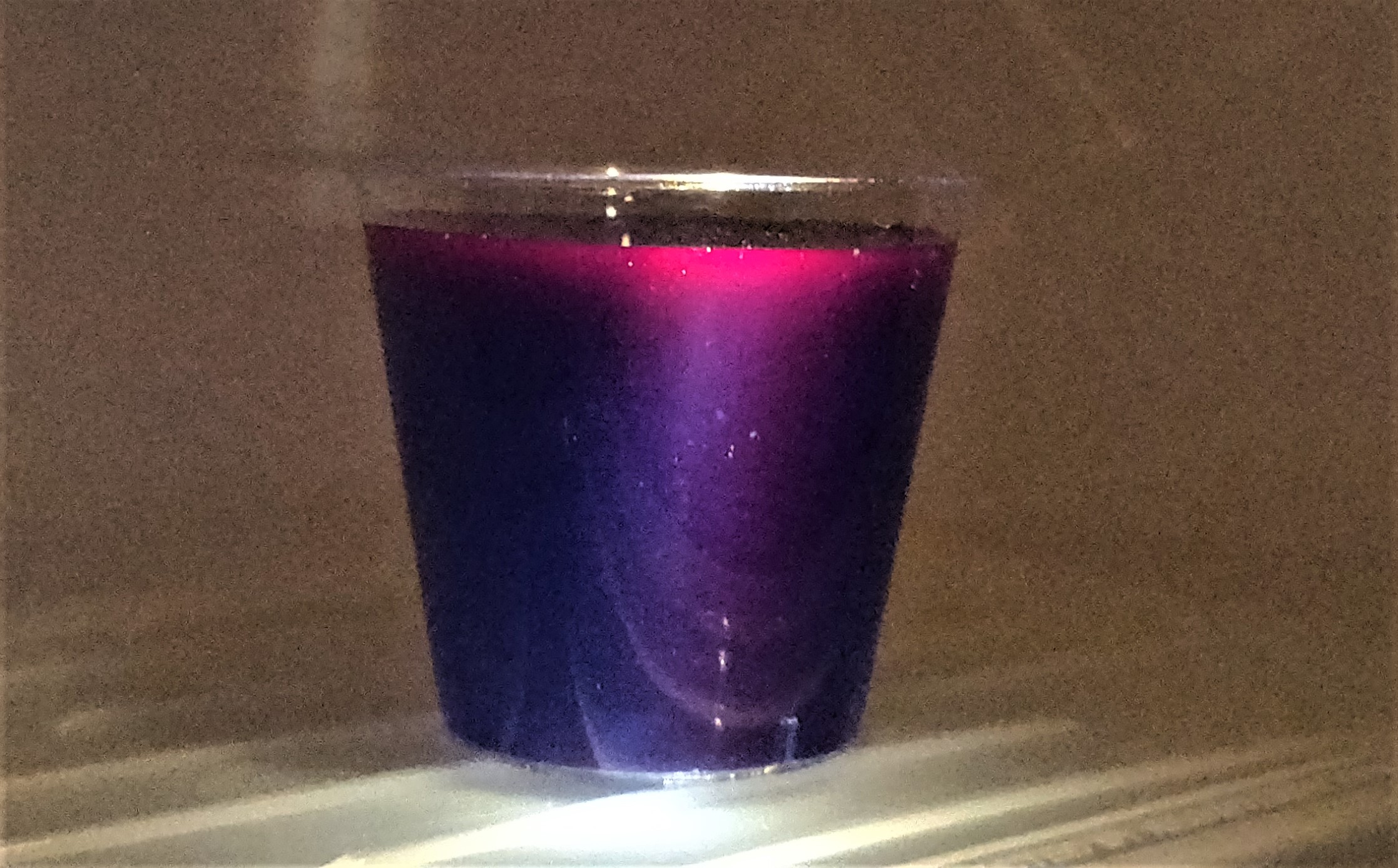 The blue colour scatters light and looks pink where the light hits it to make a rainbow in just one cup!