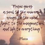 Image of hands uplifted with a light behind it, musical staff and notes are on top, with Quote by Plato at the forefront