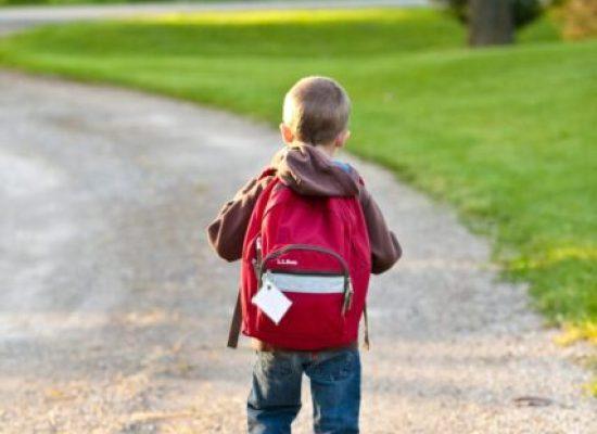 Boy walking to kindergarten