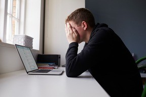 Frustrated in front of laptop