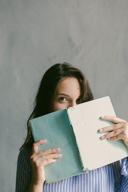 Shy Girl Behind Book