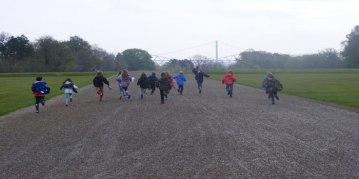 Children running down royal drive