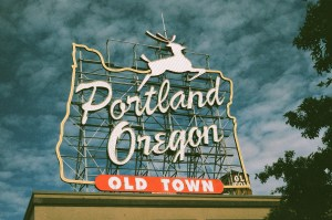 A sign that says Portland, Oregon, Old town