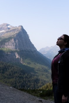 Meagan Wilson gazing up at the mountains in Glacier National Park