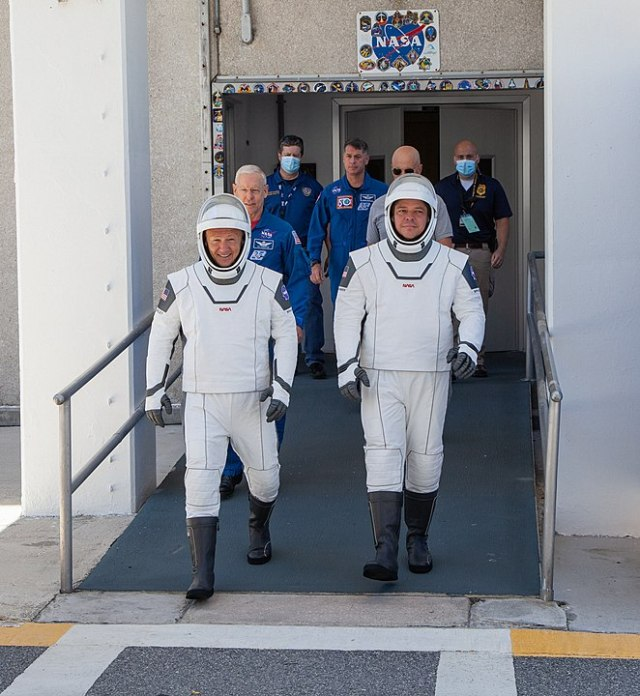 Doug Hurley (left) and Bob Behnken walk towards the launch pad at Kennedy Space Center for a dress rehearsal May 23; the two launched successfully aboard a SpaceX Falcon 9 rocket yesterday. Image: NASA/Brandon Garner.