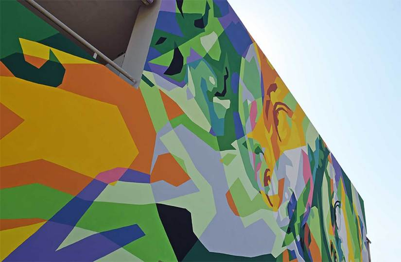 Pollution-eating murals could be a colourful way to clean city air in the future. Image Credit - AM Technology