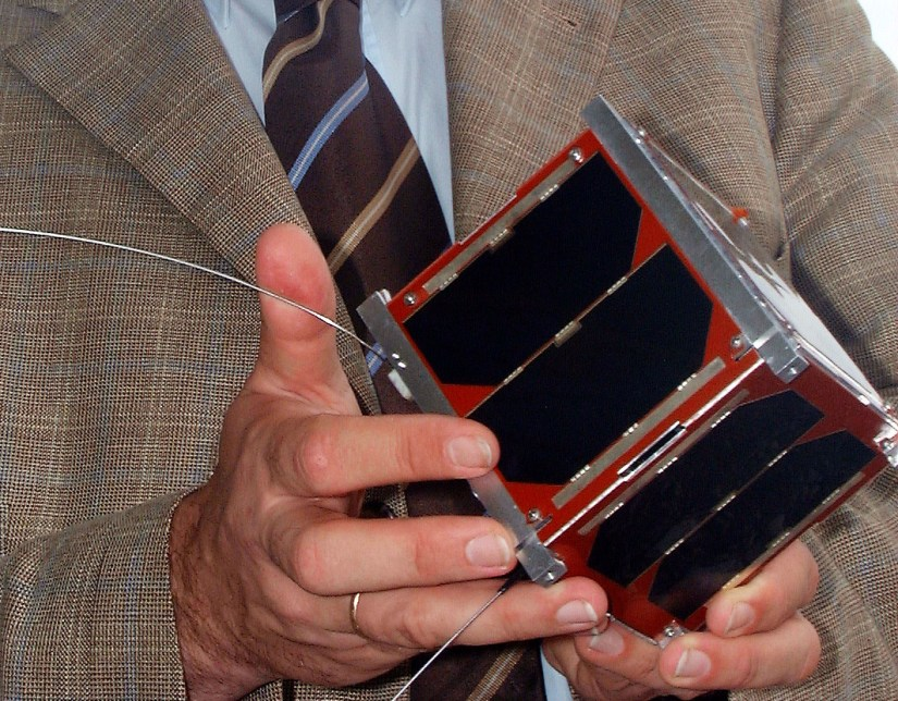 Klaus Schilling with the German first pico-satellite (a satellite with 1 kg of mass), designed and realized by his team 2005. Image credit - University Würzburg