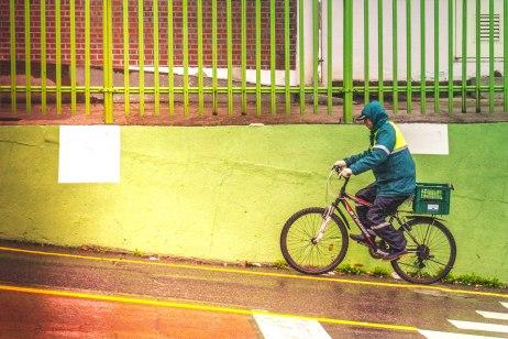 A man climbs up a hill in the rain in Donggu, Ulsan.