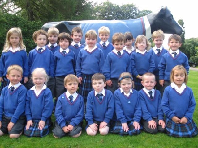 Model Cow dressed in matching uniform at Craigclowan School