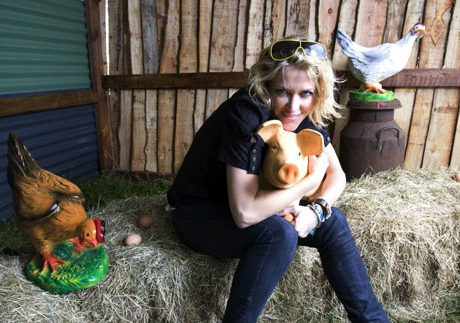 Cerys Matthews and model piglet friend at Glastonbury Festival