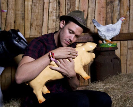 Will Young cradles model piglet at Glastonbury Festival