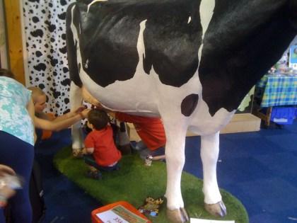 Kids Milking the Model Cow