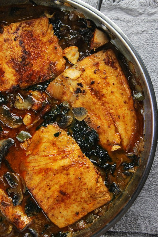Seared salmon with coconut, chile, spinach and mushrooms