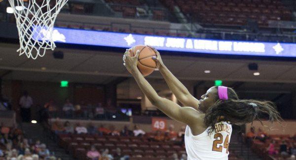 Holmes' double-double, stingy defense lift women's ...