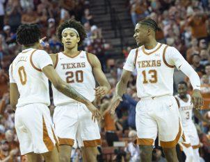 Texas teammates congratulate Sims on the dunk-
