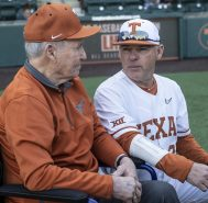 Coach Gus and Coach Pierce discussing the old and the new-