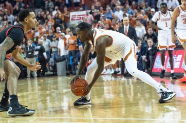 Courtney Ramey stops and looks to pass-