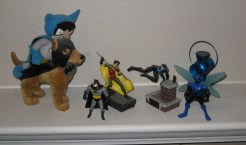 I do not collect toys or statues. But darnit, my mantelpiece was so boring before. (Bat-Mite, Ace the Bat-Hound, Batman- TAS version, Robin, Nightwing, Blue Beetle, and the Blue Lantern)