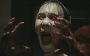 Screaming ghost from Asian horror movie