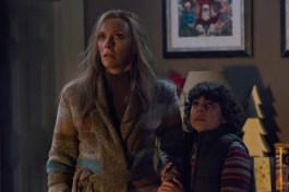 Sarah (TONI COLLETTE) and her son, Max (EMJAY ANTHONY), cannot fathom what they're seeing in KRAMPUS. ©Legendary Pictures/Universal Studios.