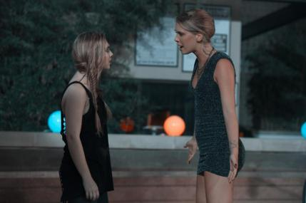 """[L-R] Sammi Hanratty as Siouxsie Hess and Ashlyn McEvers as Alyson Hess in the thriller """"BAD KIDS OF CRESTVIEW ACADEMY"""" a Momentum Pictures release. Photo courtesy of Momentum Pictures."""