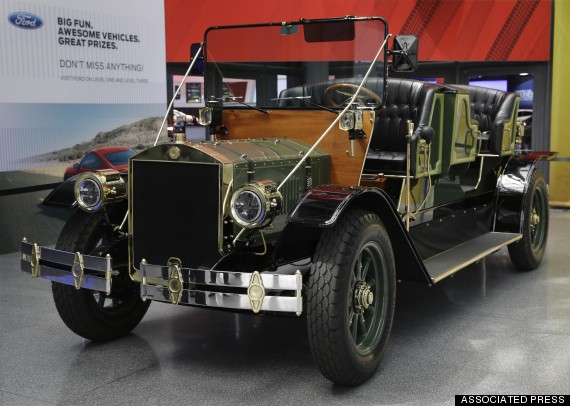 A prototype of an electric carriage is displayed at the New York International Auto Show in New York, Thursday, April 17, 2014.  A prototype of the old-timey electric cars that Mayor Bill de Blasio would like to take the place of horse-drawn carriages on New York City streets will be unveiled at the New York Auto Show on Thursday. (AP Photo/Seth Wenig)